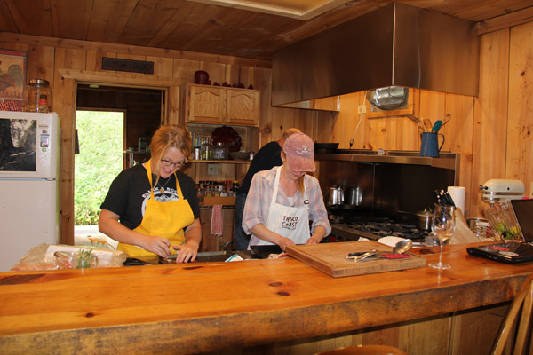 cooks prepare gourmet meals for campers