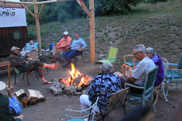people relaxing around campfire at Paradise, Idaho in selway wilderness
