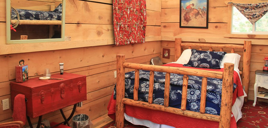 log bed in paradise, idaho glamping camp