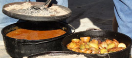 food cooking in dutch ovens