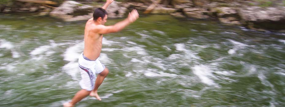 man jumping into selway river in idaho