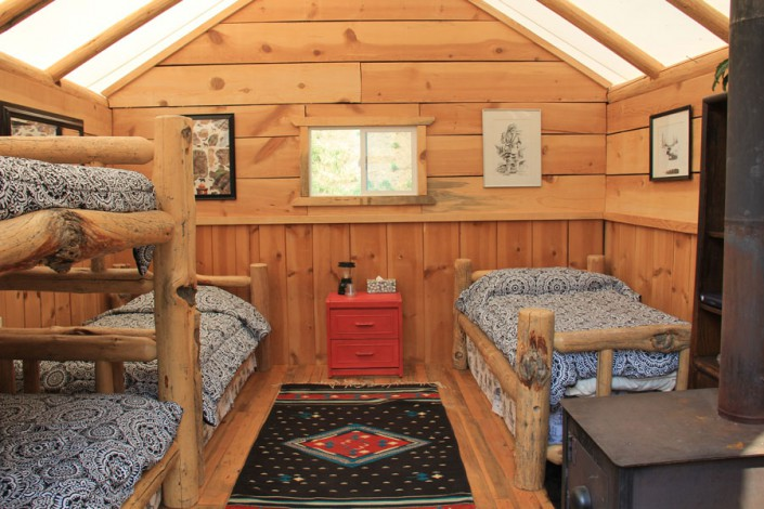 glamping cabin tent with bunks and beds and art