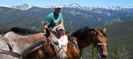 a couple on horseback ride